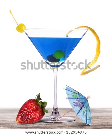 Set of alcoholic cocktail on a vintage wooden table with tasty strawberry and umbrella - stock photo