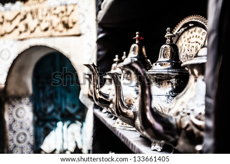 Set of arabic nana mint tea with metal tea pot and glasses - stock photo