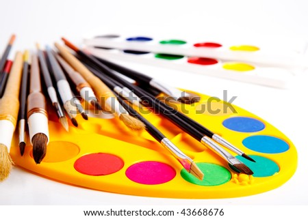 Set of artistic paintbrushes and paints isolated - stock photo