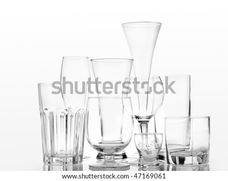 Set of assorted alcoholic glasses over white background