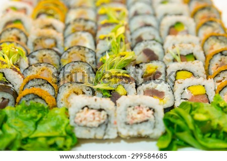 Set of assorted japanese seafood sushi (raw fish and rice) on a white dish - stock photo