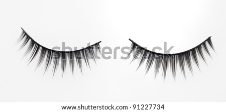 Set of attractive fake eyelashes in white background. - stock photo