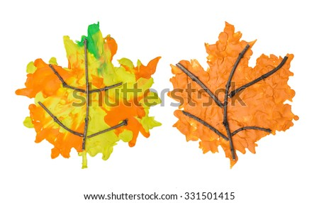 Set of autumn maple leafs made from plasticine and branches on white background - stock photo