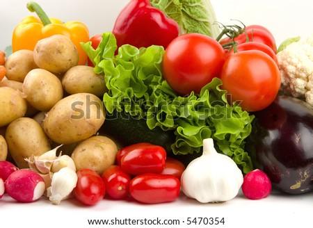 Set of autumn vegetables on white table - stock photo
