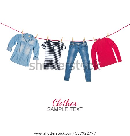 Set of basic woman clothes hanging - stock photo