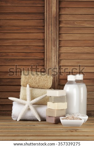 Set of bath accessory in wooden bathroom. - stock photo