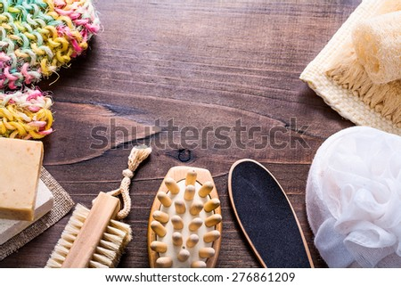 set of bathroom items on vintage wooden boards  - stock photo
