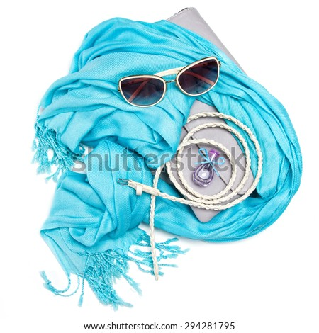 Set of beautiful fashion accessories. Grey women's handbag, blue fringe scarf, skinny braided belt, sunglasses and small bottle of perfume on white background. Attributes of stylish modern girl - stock photo