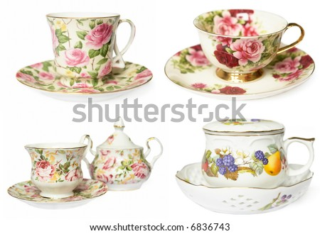 set of 4 beautiful porcelain tea-cups isolated on a white background - stock photo