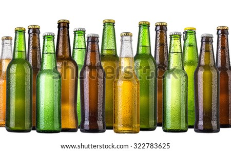set of Beer bottles with water drops anb beer glasses on white background.Five separate photos merged together. - stock photo