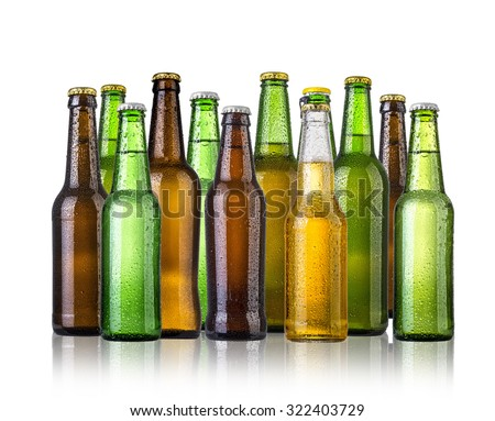 set of Beer bottles with water drops anbd beer glasses on white background.Five separate photos merged together. - stock photo