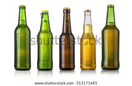 set of Beer bottles with water drops on white background.Five separate photos merged together. - stock photo