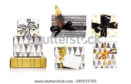 Set of black and white gift boxes with bows and ribbons - stock photo