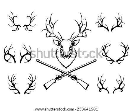 Set of black antlers silhouettes with a central trophy and guns in a hunting or deer stalking concept - stock photo