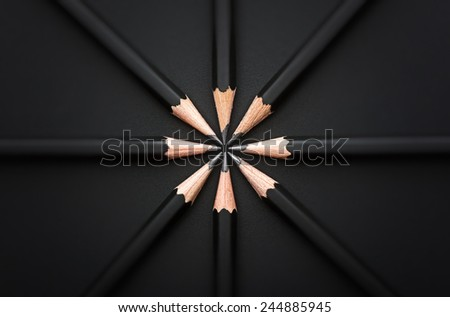 Set of black pencils on black background - stock photo