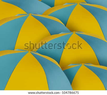 set of blue and yellow sunshades or sea umbrellas in the beach. - stock photo