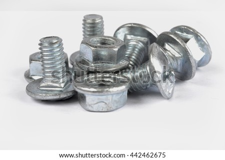 Set of bolts on the white background. - stock photo