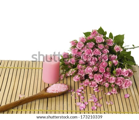 Set of bouquet rose with candle ,salt in spoon on bamboo mat