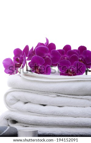 Set of Branch red orchid and stone ,candle and white towel - stock photo