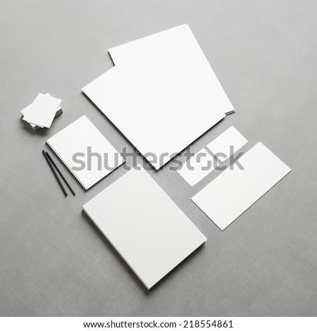 Set of branding elements on fabric background - stock photo