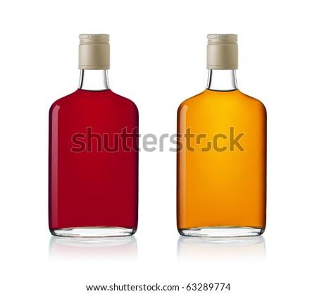 Set of brandy bottles isolated on white background - stock photo