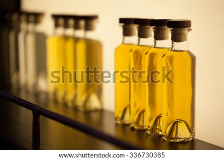 Set of brandy bottles of different ages - stock photo