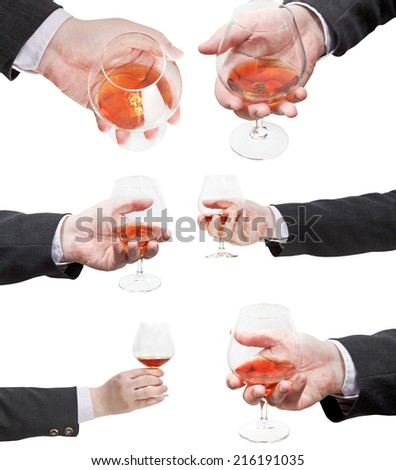 set of brandy glasses in businessman hand isolated on white background - stock photo