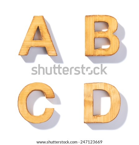 Set of brown wooden symbols A, B, C, D with 45 degree long shadow as a real life flat design font elements, isolated over the white background - stock photo