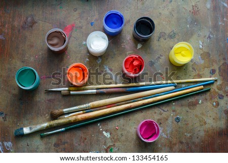 Set of brushes and paints on the table - stock photo