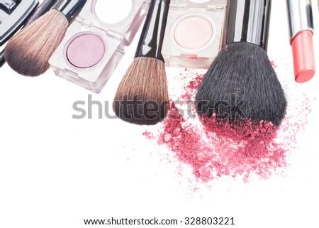 set of  brushes, lipsticks and  eye  shadows isolated on white background - stock photo