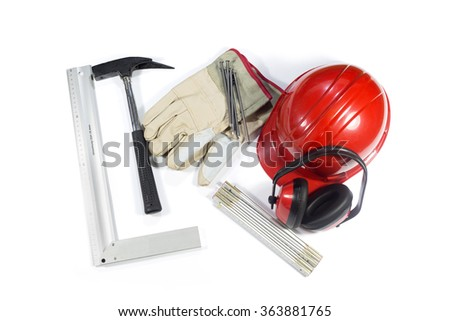 Set Of Building Tools - Protective Earmuffs, Hammer, Nails, Gloves, Protective Helmet And Folding Ruler Isolated On White Background - stock photo