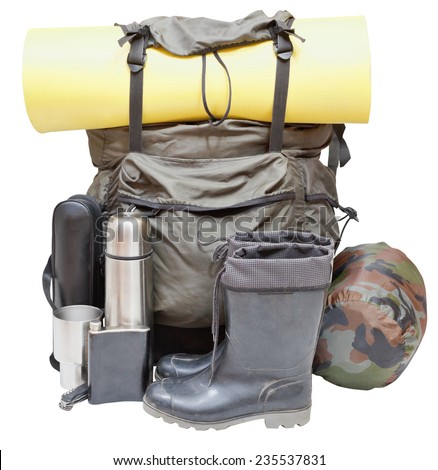 set of camping equipment with backpack, rolled sleeping pad, boots, thermos, knife, flask, can, sleeping bag isolated on white background - stock photo