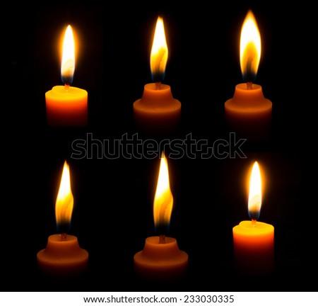 Set of candle light isolated on black background - stock photo