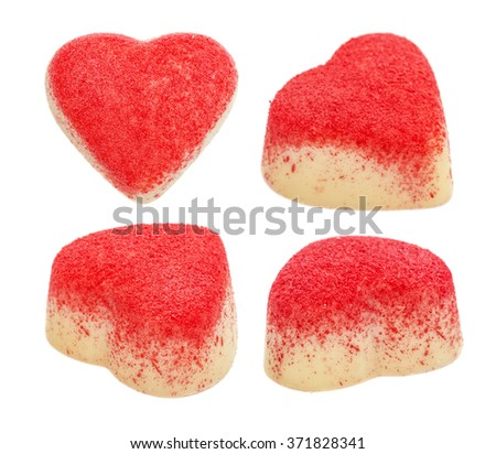 Set of candy from white chocolate in the form of heart strewed with a red sugar crumb, isolated on the white - stock photo