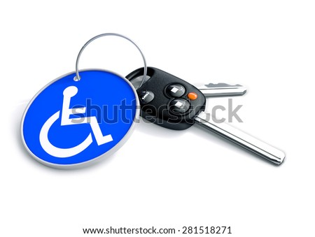 Set of car keys with keyring and a wheelchair icon on it. Concept for assisted driving and issues endured by handicapped persons when driving.