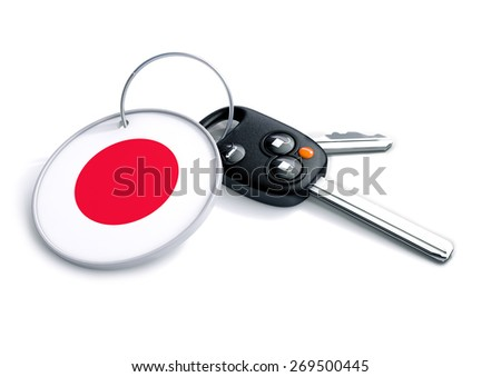 Set of car keys with keyring and Japanese Flag symbol. Concept for Japanese car manufacturer, buyer or selling a vehicle in the Japan. - stock photo