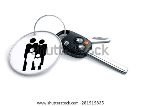 Set of car keys with keyring with family icon. Concept for owning a family or passenger sedan or car.