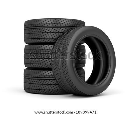 Set of car tires on white background - stock photo