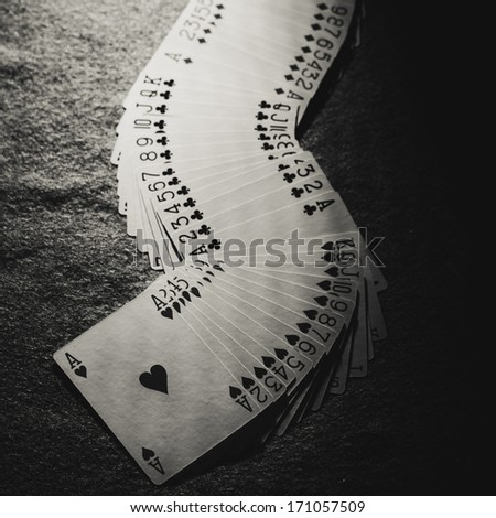set of cards on a poker table - stock photo
