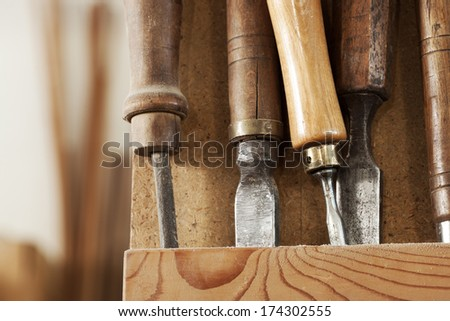Set of carpenter tools on a wooden rack. - stock photo