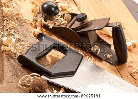 set of carpenters tool on tne wood and shavings - stock photo