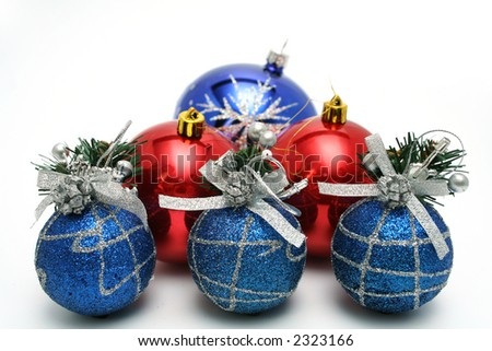 Set of celebratory christmas-tree decorations of dark blue and red color on a white background - stock photo