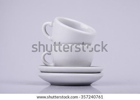 set of ceramic cups on a white background - stock photo