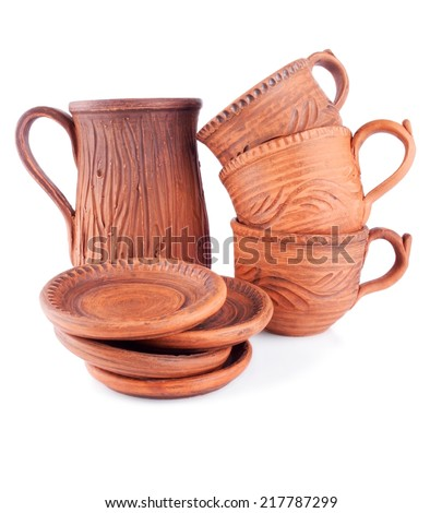 Set of Ceramic Dishes consisting of Cups, Saucers and Pitcher - stock photo