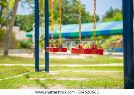 Set of chain swings on modern kids playground - stock photo