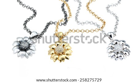 set of chains with floral pendants isolated on white