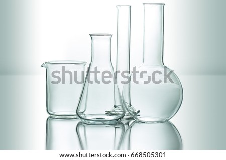 set of chemical glassware on reflective surface