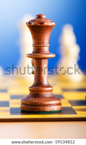 Set of chess figures on the playing board - stock photo
