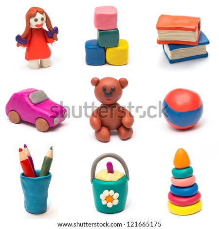 Set of children's toys molded from clay. - stock photo