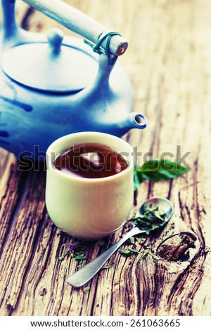 Set of China tea/ Chinese style herbal floral tea over wood table with raw ingredients  - stock photo
